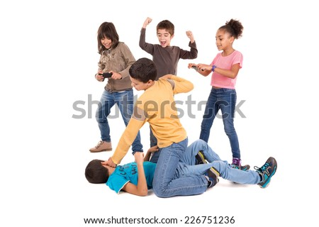 Boys fighting with other kids cheering and filming - stock photo