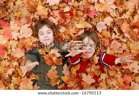 Boys Having Fun Throwing Leaves - stock photo