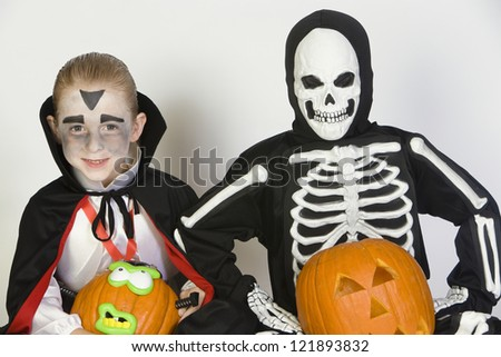 Boys in Halloween outfit together with pumpkins isolated over white background - stock photo