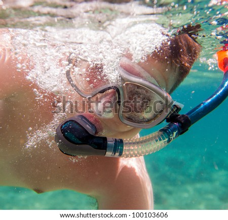 boys in the sea, snorkeling