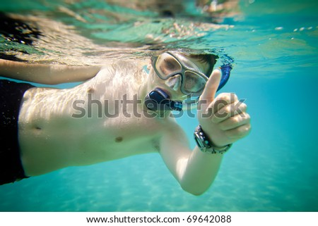 boys in the sea, snorkeling the Red sea - stock photo