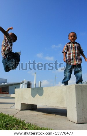 Boys Jumping Around - stock photo