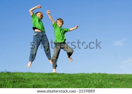 boys jumping with joy - stock photo