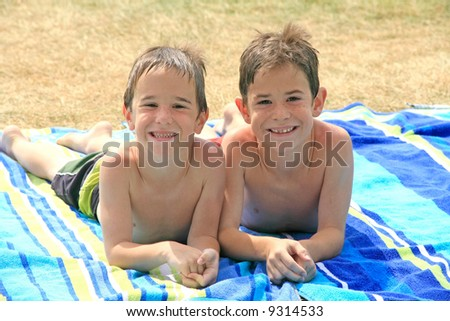 Boys Laying on Beach Towels