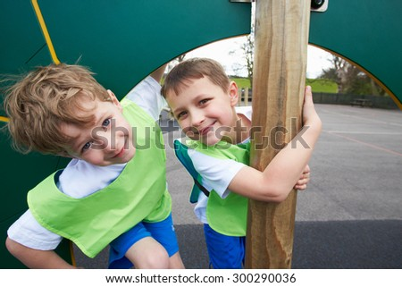Boys On Climbing Wall In School Physical Education Class - stock photo