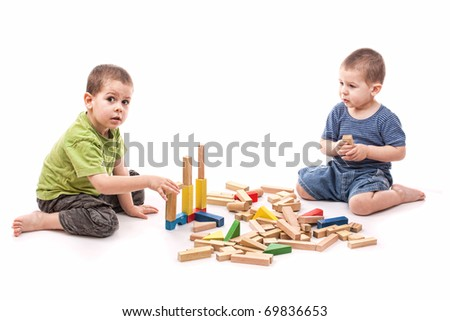 Boys playing whit blocks isolated on white - stock photo