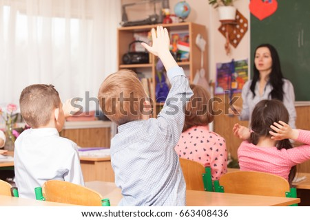 Boys raised hand in class