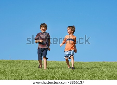 Boys Running Down A Hill - stock photo