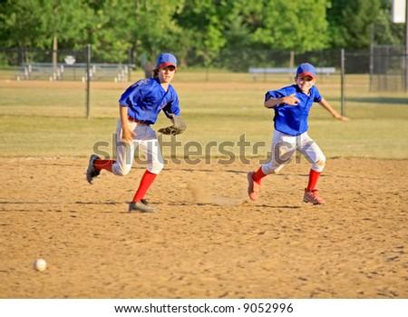 Boys Running for the Ball - stock photo