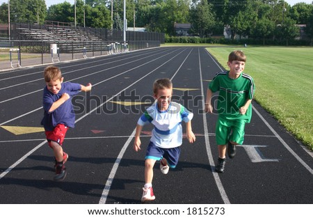 Boys Running on Race Track - stock photo