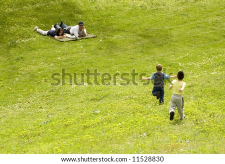 boys running to their grandparents - stock photo