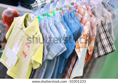 boys' shirts in a clothes shop - stock photo