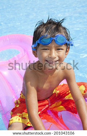 Boys swimsuit floating in the pool float