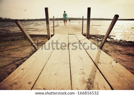 Boys walking out on a dock