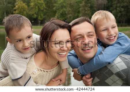 boys with his family in the  summer park