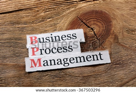 BPM business process management on  paper ,wooden background