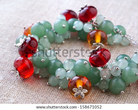 bracelet from glass beads and gemstone beads - stock photo