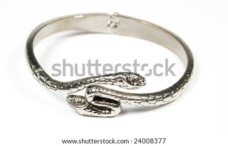 Bracelet from silver metal in a kind a two-head of a snake - stock photo