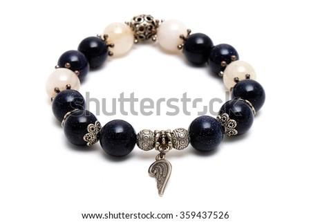 bracelet mix lucky bluesand stone and golden Rutillated Quartz  with white isolate background - stock photo