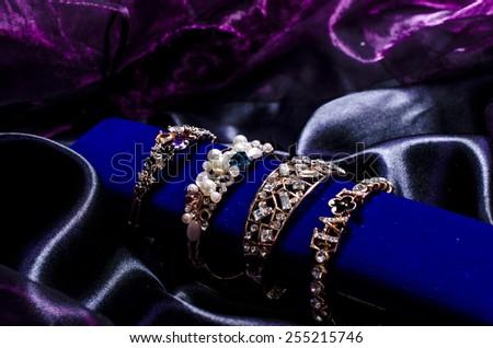 bracelet set on a silk cloth - stock photo