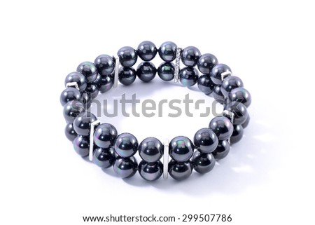 Bracelet with black pearls isolated on white - stock photo