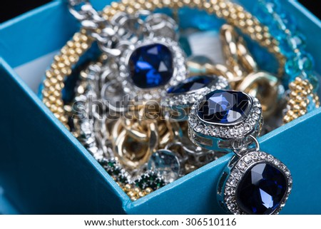 Bracelet with blue stones in a box  - stock photo