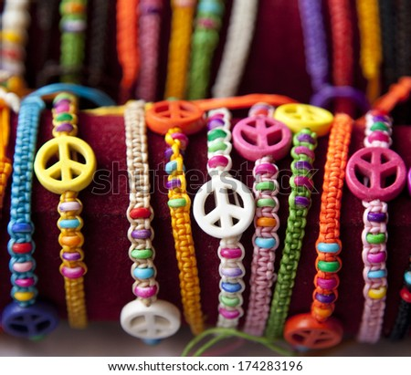 Bracelet with peace sign - stock photo