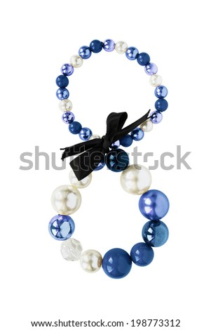 Bracelet with pearl and blue beads isolated over white - stock photo