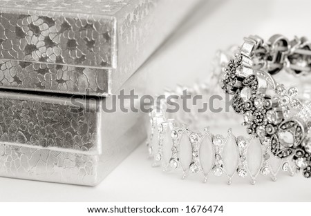 bracelets and box with toner - stock photo