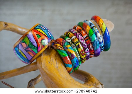 Bracelets jewelry made of wood with abstract patterns. Painted in the Latin American style - stock photo