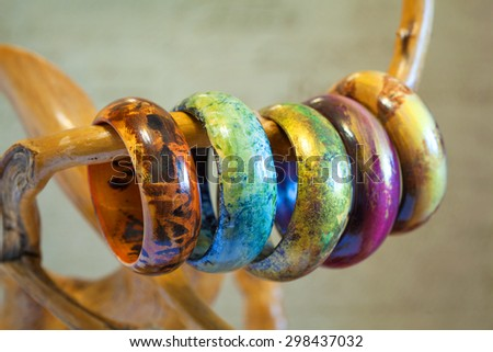 Bracelets made of wood and painted by hand. Handmade items - stock photo
