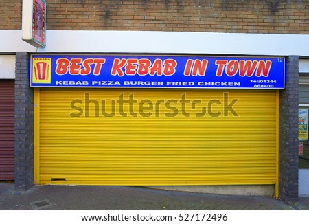 Bracknell,England - December 01, 2016: Closed yellow shutter of the Best Kebab In Town, a fast food establishment in Bracknell, England