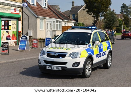 BRADFORD ON AVON - APR 21: A police car responds to an emergency on Apr 21, 2015 in Bradford on Avon, UK. Bradford on Avon is policed by the Wiltshire Constabulary covering 1346 square miles.  - stock photo