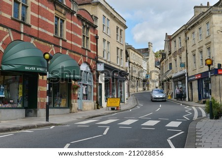 BRADFORD ON AVON - AuG 17: Street view in the old town on Aug 17, 2014 in Bradford on Avon, UK. The historic Wiltshire town was a centre for the wool industry during the industralisation era. - stock photo