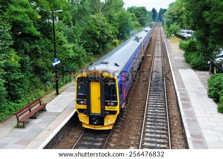 BRADFORD ON AVON - JUL 1: A train departs the town station on Jul 1, 2010 in Bradford on Avon, UK. Opened in 1825 the rail system of the UK is the world's oldest, currently with 15,800 km of line. - stock photo