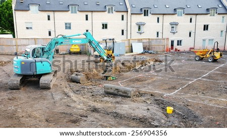 BRADFORD ON AVON - JUL 13: View of an excavator on a construction site in the town centre on Jul 13, 2010 in Bradford on Avon, UK. The historic Wiltshire town is undergoing redevelopment. - stock photo
