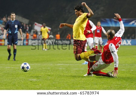 BRAGA, PORTUGAL - NOVEMBER 23: Carlos Vela (L), Arsenal (ENG) gets tackled by Alberto Rodriguez inside the penalty area at the UEFA Champions League match on November 23th, 2010 in Braga, Portugal - stock photo