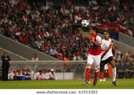 BRAGA, PORTUGAL - SEPTEMBER 28: Braga's defender Luis Aguiar(L), plays the ball with the head near Shakhtar Donetsk (UKR) forwarder Willian in Champions League on September 28, 2010 in Braga, Portugal - stock photo
