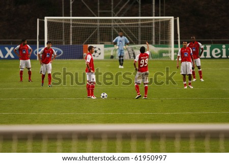 BRAGA, PORTUGAL - SEPTEMBER 28: Braga's (POR) players feel defeated after suffering the 3rd goal from Shakhtar Donetsk's (UKR) in UEFA Champions League match on September 28th, 2010 in Braga, Portugal - stock photo