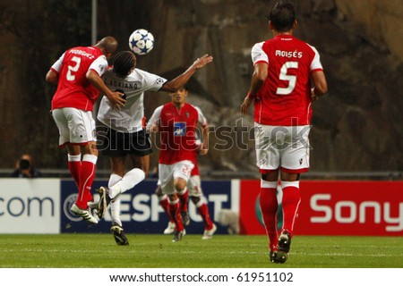 BRAGA, PORTUGAL - SEPTEMBER 28: Rodrigues(L), Braga (POR) defender, divides the ball with Shakhtar Donetsk (UKR) forwarder Luis Adriano in Champions League on September 28, 2010 in Braga, Portugal - stock photo
