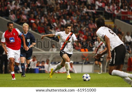 BRAGA, PORTUGAL - SEPTEMBER 2010: Shakhtar Donetsk's (CHK) midfielder dribles through Braga's (POR) defence in UEFA Champions League match on September 28, 2010 in Braga, Portugal - stock photo