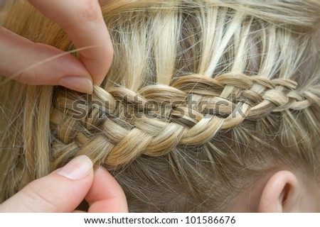 Braid one's hair - stock photo