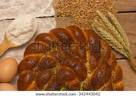 Braided bread and ingredients, eggs and wheat flour.