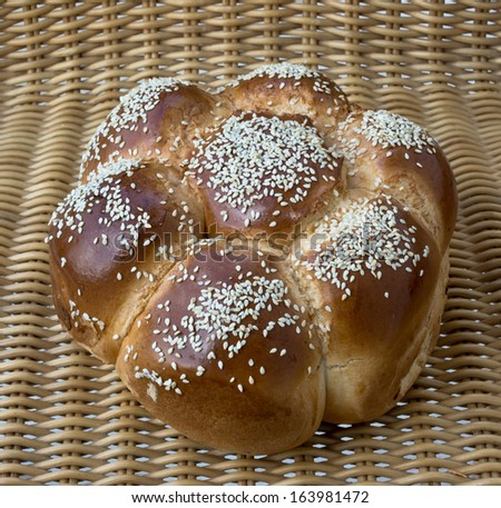 Braided challah on brown background. - stock photo