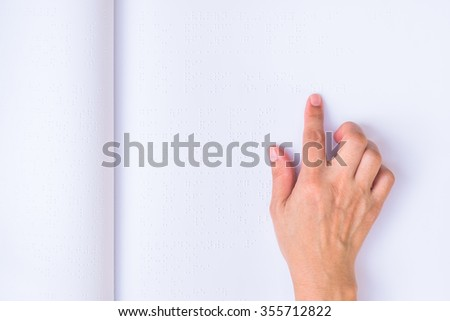 Braille book with visual impaired/ low vision person's hand/ finger touching paper texture reading the sign: The blind accessibility in equal education literacy concept: Human rights to learn  - stock photo