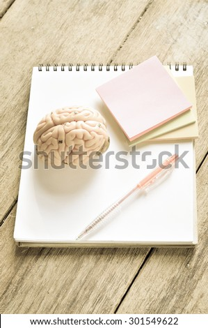brain and work table with retro style - stock photo