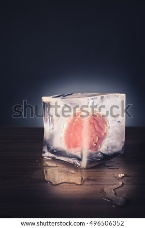 brain freeze concept with brain inside an ice cube