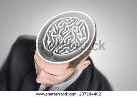 Brain maze in businessman's head - stock photo