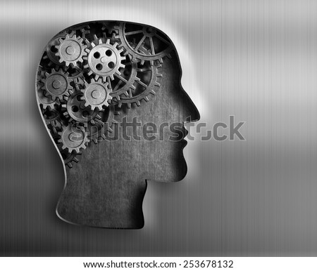 Brain model from gears and cogs in metal plate. - stock photo