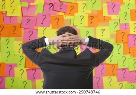 Brainstorming. Businessman solves complex problem - stock photo